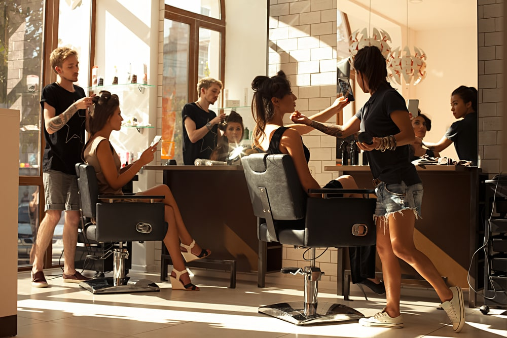 People doing hair in a salon.